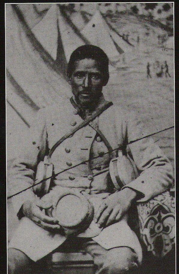 Black confederate soldier sitting for portrait. American Civil War