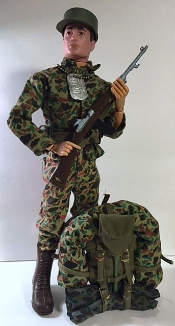 1965 Marine shown with Standard rifle and web belt.  Also show a completed field pack as outlined in the manual.  Combined sets are, 7700 Action Marine, 7702 Communications Poncho, 7711 Beach Head Assault Tent, 7713 Beach Head Assault Pack, 7515 Bivouac Sleeping Bag.