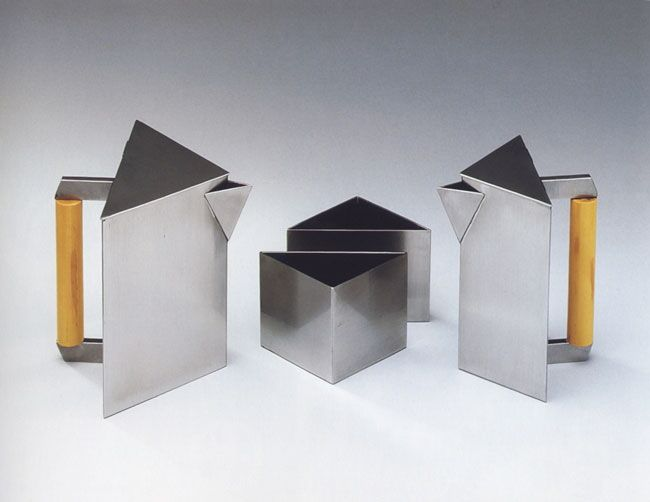 """Dulany's 1934 geometric coffee set is currently on display at the Metropolitan Museum of Art; it includes small and large coffee pots with Bakelite handles, as well as triangular sugar and cream vessels.  