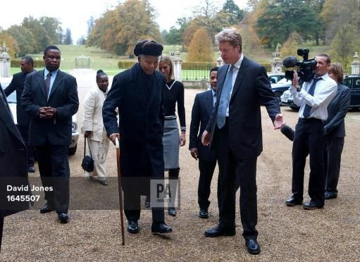 nov 1, 2002--Former South African president Nelson Mandela arrives at Althorp, Northamptonshire on a visit to the grave of Diana, Princess of Wales, and meets her brother Earl Spencer (centre right). * Mr Mandela, 84, was planting a tree in the grounds of the estate and laying a wreath at the island burial site during the visit
