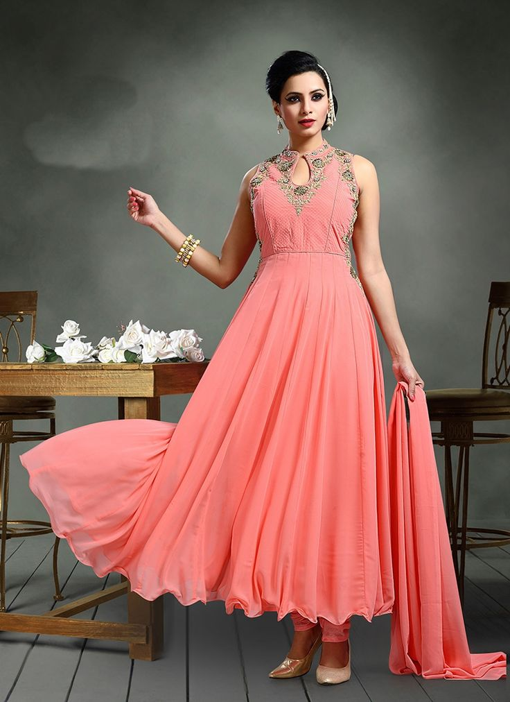 Make the heads turn whenever you costume up with this peach georgette anarkali salwar kameez. The zari and stone work appears chic and perfect for wedding and festival. Comes with matching bottom and dupatta.