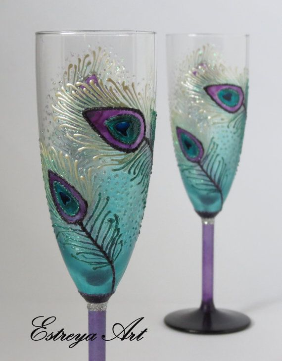 """Set of two hand painted toasting flutes """"Purple Peacock Feathers"""" These colorful glasses are in white, turquoise, purple and blue with frost effect and glitter. They are unique and perfect present for weddings, anniversaries, birthdays, special occasions or just for romantic /special dinners. All items can be personalized with short text as names and/or date written at the base of the flutes /no additional fees apply/ so just write your wish in Notes to seller field at c..."""