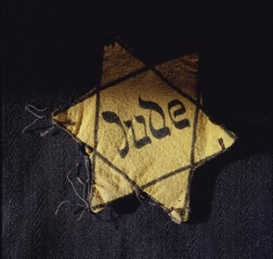 remember history ......dark time in history...A yellow Star of David badge bearing the German word Jude. - Picture from the USHMM, courtesy of Charles and Hana Bruml.