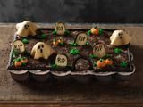 Pull Apart Graveyard Cupcakes - Although it looks almost like a cake, this graveyard is made up of individual cupcakes, making it a self-serve party option. Just grab your cupcake and go — no knives necessary.