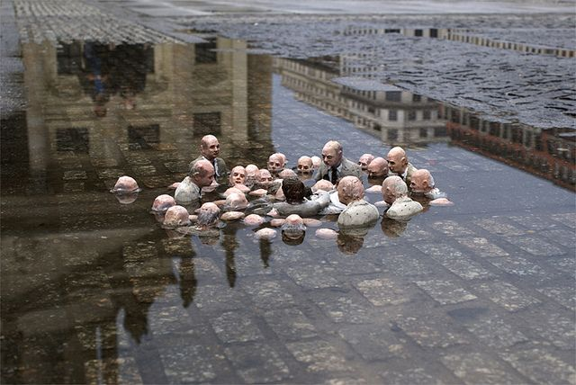 Isaac Cordal depicts political figures debating about the effects of climate chsnge.