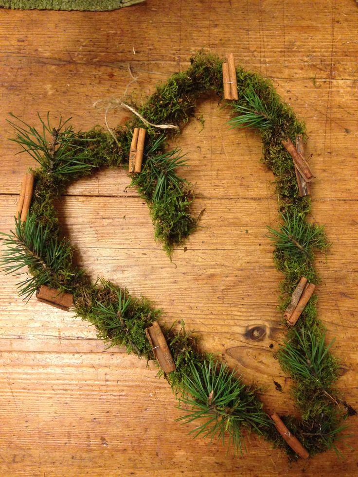 Moss heart for christmas with cinnamon and pine