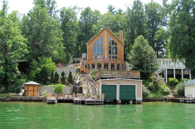 Love this! Simple, but not :) Two boat garages on the water