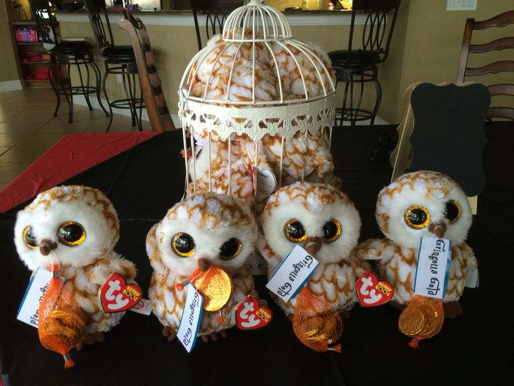 """Harry Potter Party Favors Hedwig I bought Beanie Boos Swoops Owl and tied on its beak bags of chocolate gold coins. I added a sticker that says: """"Gringotts Gold"""""""