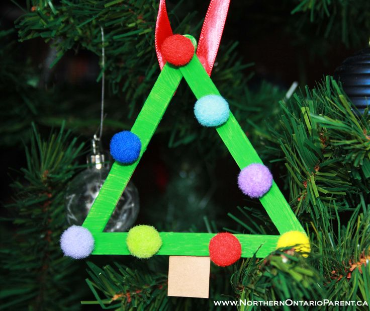 Popsicle Stick Christmas Tree - Craft for Kids  http://www.northernontarioparent.ca/#!craft--triangle-popsicle-stick-tree/c1ylt