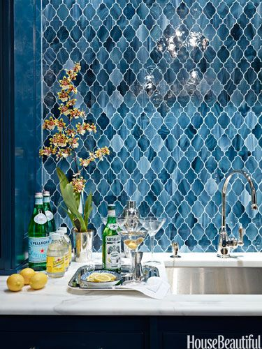 """Exotic Bar  Designer Ashley Whittaker's clients """"wanted a house with comfortable rooms for the family and formal rooms where they could entertain."""" For the bar, she choose Aladdin tile from Waterworks to conjure up an exotic Moroccan feel."""