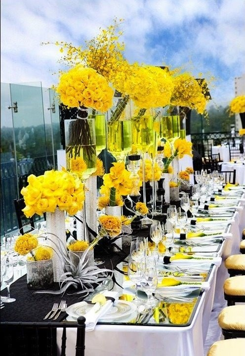 Crazy yellow Centerpieces. Could get inspiration from one or two small pieces.