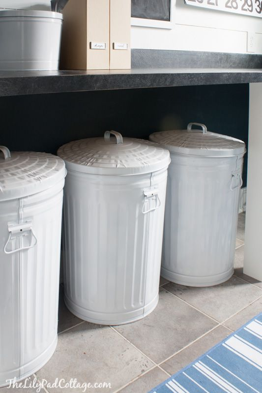 Navy Laundry Room Makeover and a Giveaway - The Lilypad Cottage  Love the trash cans as laundry hampers