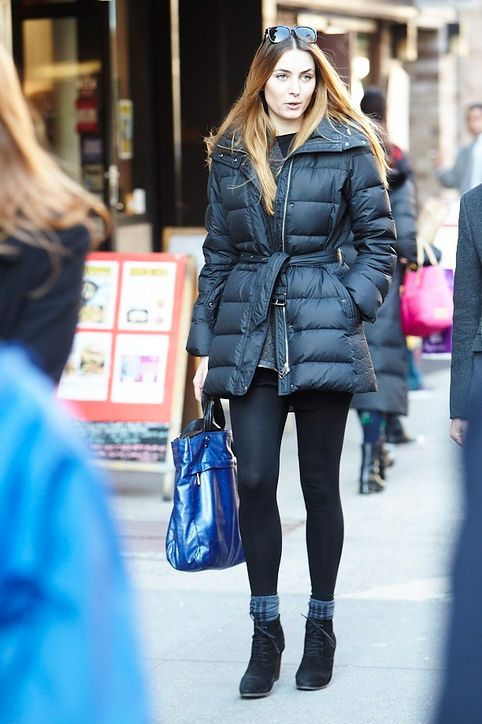 Winter outfit idea: Bundle up in an unzipped, cinched puffer coat.