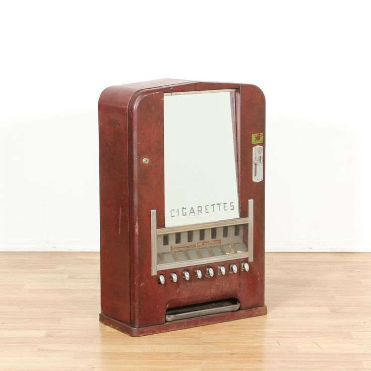 This antique art deco vending machine is featured in a metal with a distressed brown red finish. This cigarette dispenser box has a mirror front with interior slots and a curved top. Eye catching and unique piece with tons of character! #americantraditional #decor #accents #sandiegovintage #vintagefurniture