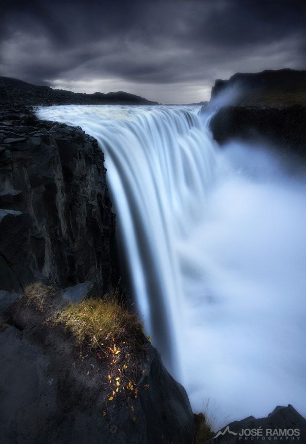 Resistance by José Ramos            If the river of life is running frantic and impatient, crushing order and impetus in ruthless ways, step aside to the margin and just watch, as growth will blossom spontaneously.Story:Image made on the third day of my 2014 trip to ICeland. After spending several hours in Godafoss, and trying to resist the impulse to stay there all day in sensory ecstasy, I decided to leave this spot if I still wanted to witness from up close the power of the waterfall with…
