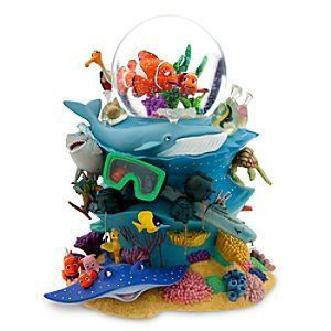 Finding Nemo Snowglobe $79.50.     Wind up to hear Over the Waves.     Shake globe to see iridescent flakes swirl around Marlin and Nemo.     Highly detailed sculpture includes Marlin, Nemo, Dory, Bruce, Squirt, Crush, Tad, Pearl, Sheldon, Bubbles, Gil, Peach and Mr. Ray.