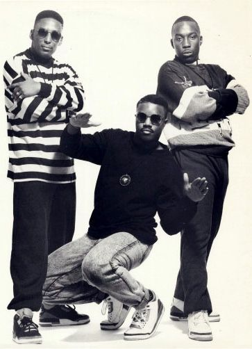 """Three Times Dope, aka 3xD, hip-hop trio consisting of EST (Robert Waller), Chuck Nice (Walter Griggs) & Woody Wood (Duerwood Beale). They were also part of the Hilltop Hustlers Crew collective. The group became well known for the terminology they created, such as """"Acknickulous"""" & """"The Giddy Up"""", as well as for their comedic rhymes & boasting. Their hits include Funky Dividends, Greatest Man Alive, Original Stylin', From da Giddy Up, Weak at the Knees, & Off da Head."""