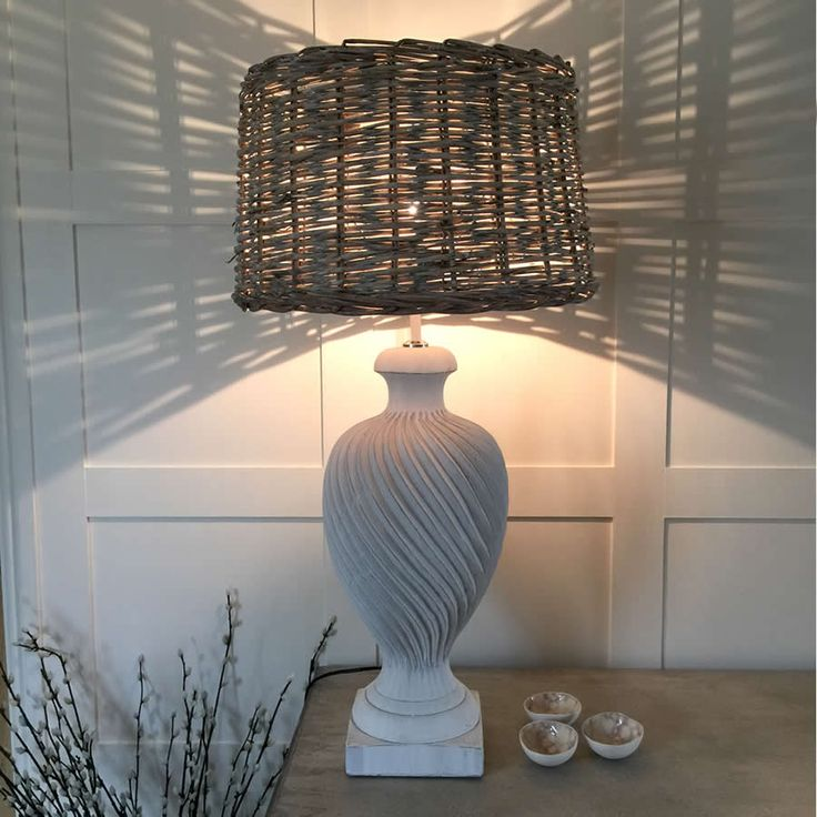 Cool Whites and wicker are a perfect marriage for a coastal property