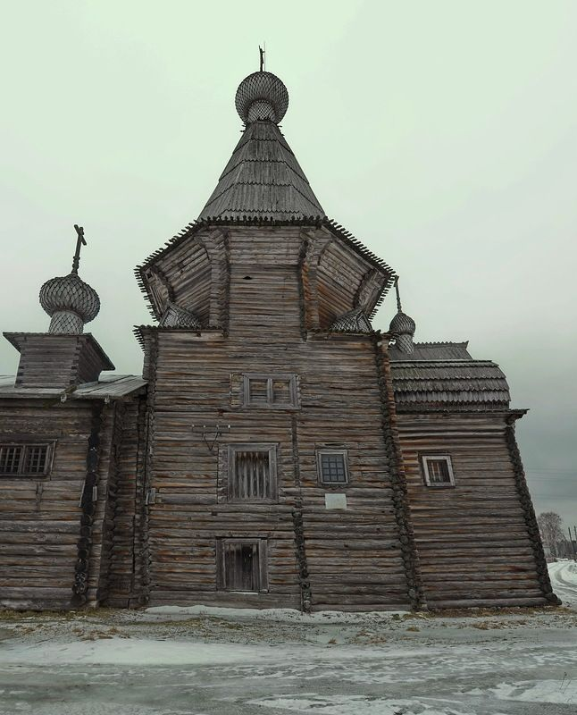 This old church standing on the plain of Kargapol, Russia, is open to wind and weather, and the wasteland spreads around for many kilometres. The church is dated 1655, being one of the oldest architectural
