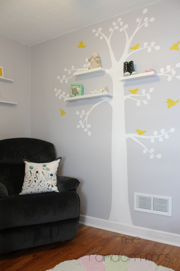 Central focal tree decal with yellow birds & shelving on light gray wall.