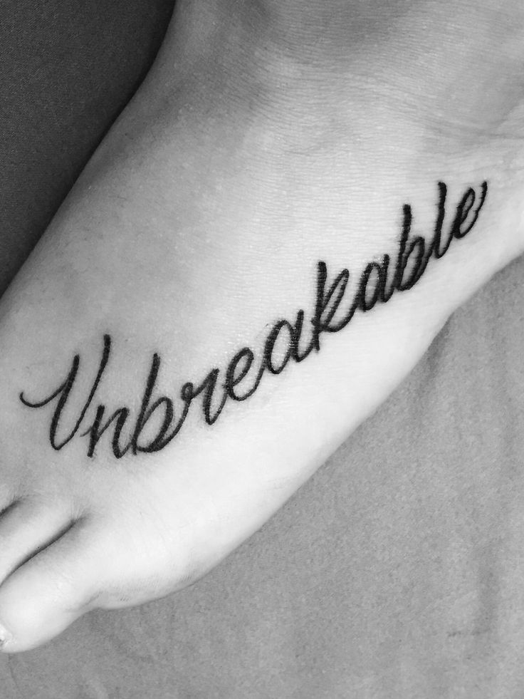 Unbreakable tattoo on left foot