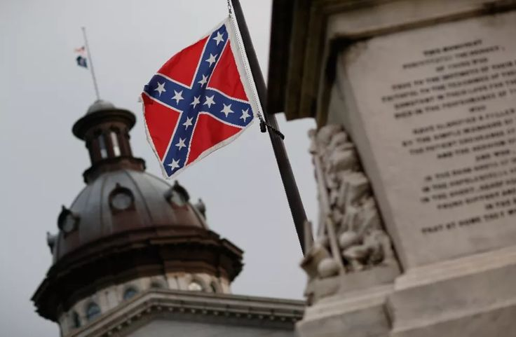 The Confederate flag flies on the Capitol grounds on June 23, 2015 in Columbia, South Carolina