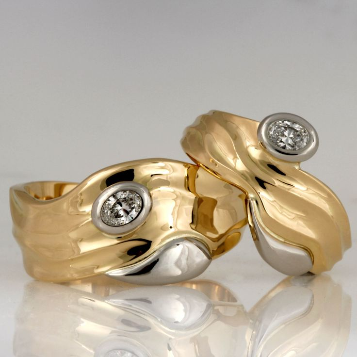 Handmade palladium and 18ct yellow gold oval diamond wedding rings
