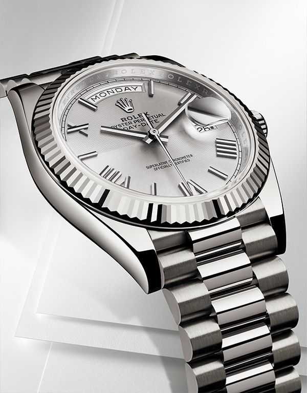 The Rolex Oyster Perpetual Day-Date 40 in 18ct white gold with a fluted bezel and roman numeral hour markers. A modern watch with classic, gentlemanly details.