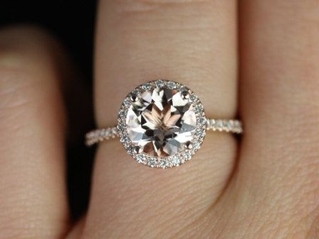 I think this is the perfect engagement ring. Rose gold, pink morganite encircled by diamonds. So lovely! And the wedding band sits flush with the ring. A thin rose gold band encrusted in tiny diamonds would be wonderful ^.^
