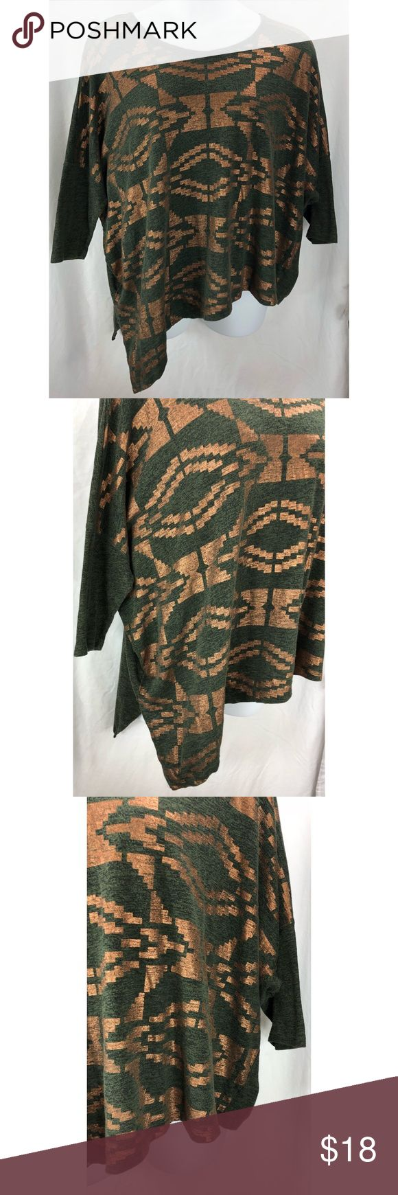 Lane Bryant Shirt batwing/dolman Metallic 5251 Lane Bryant Shirt batwing/dolman Aztec Metallic Print Asymmetrical Women's Size:  18/20 Approx measurement: armpit to armpit - 37 1/4 inches; length - 23-28 inches Fabric content: 55% cotton, 45% polyester Machine washable Gently used - see pictures Lane Bryant Tops