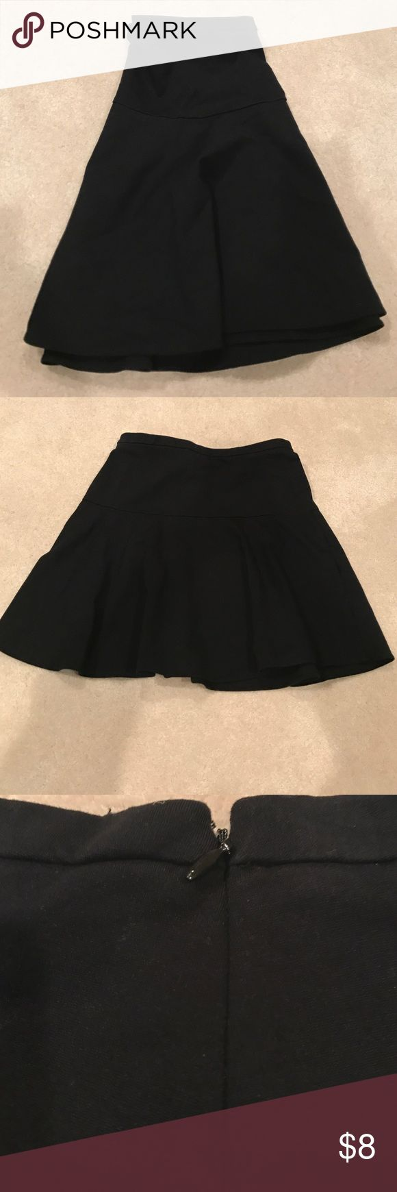 Cheer me on black skirt This pleated black skater skirt is super comfy ! Wore once. Has a side zipper. In perfect new condition. Merona. Stretch extensible. Size 12. Merona Skirts