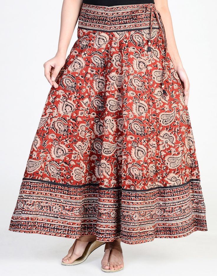 Make a style statement with this long skirt. This skirt is perfect for those who like their skirts to swirl with movement. The skirt made using cotton fabric features kalamkari print which accentuates the look and makes it a versatile option for casual wear.  Cotton Fabric Drawstring Tie Up Waist Hand Wash Separately in Cold Water
