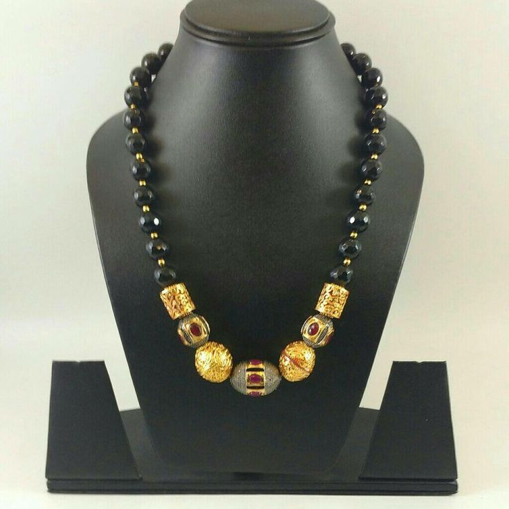 Black neck piece with meenakari beats