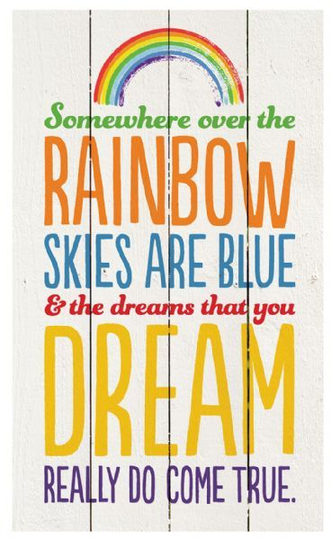"Gorgeous and rustic, this wooden wall sign with the inspiring ""Somewhere Over the Rainbow Skies Are Blue and the Dreams that you Dream Really Do Come True"" written in striking typography is bound to be a delightful addition to any room."