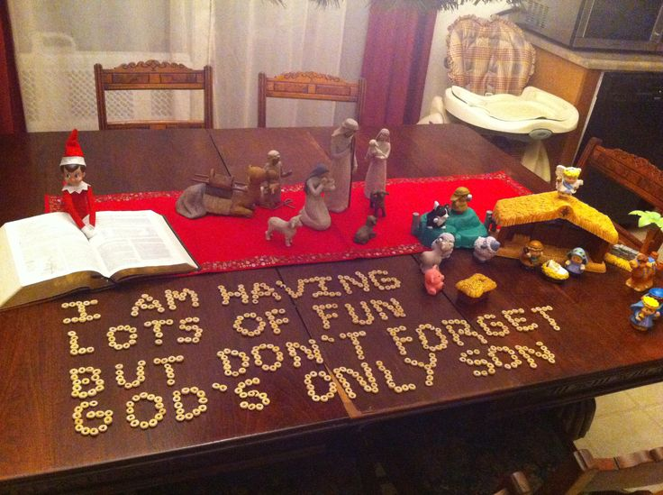 Our Elf wants to be certain the kids remember the true meaning of Christmas. He's reading the Christmas story from the Bible & he brought the little ones their own nativity to play with instead of mommy's.