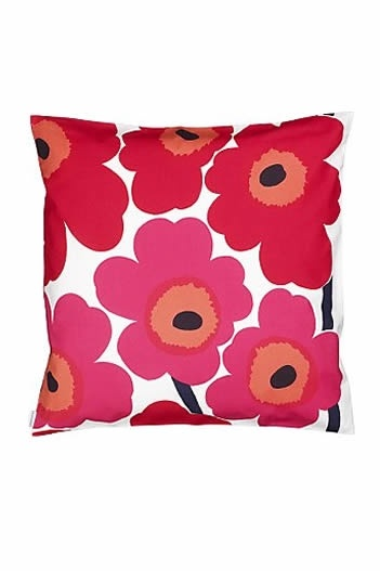marimekko unikko pattern. have this pillow as well as sheets with the blue unikko.