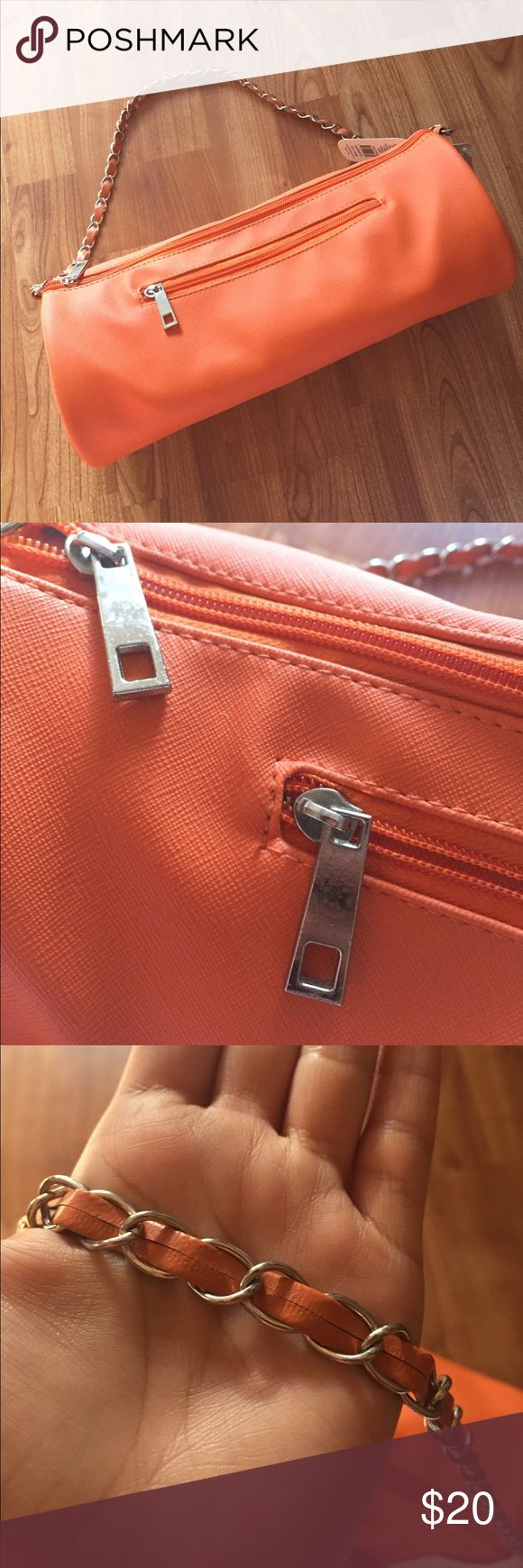 Orange Wine Purse Orange wine purse with silver hardware. Fits a standard bottle of wine perfectly 😊 could be used as a lunch bag or purse. Interior is insulated. Small scuff on one of the ends(see last photo). Bags