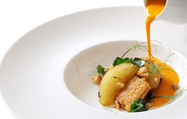 Pumpkin velouté with chicken wings, apples and almonds