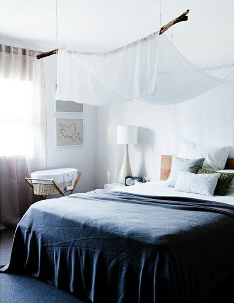 Love the branch and the fabric drape. it's a simplistic way to do a canopy over a bed.