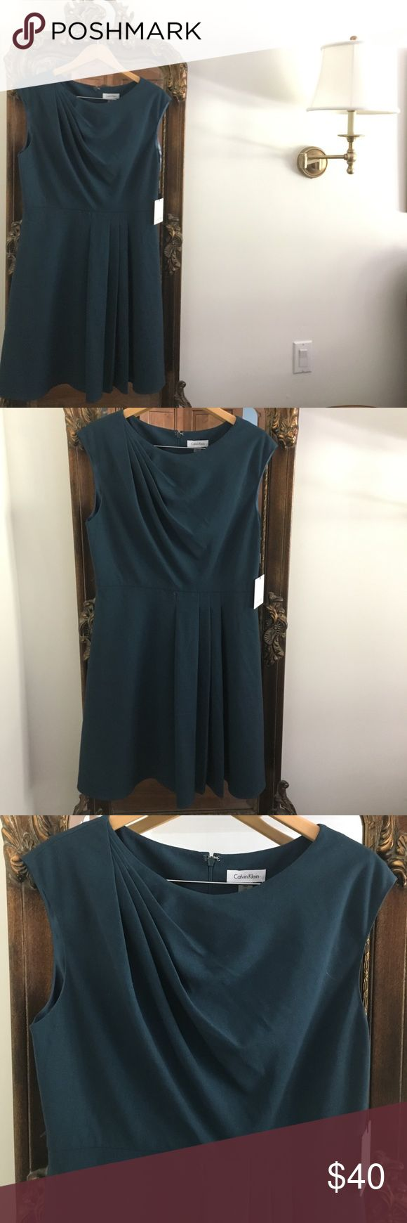 Calvin Klein tailored dress Perfect for work! Has a really unique fit and flair fit for a tailored dress. Very very flattering! Never worn and still has the tags. Beautiful dealing detail and subtle pleating at the skirt. The color is a rich, jewel toned, deep turquoise. Calvin Klein Dresses