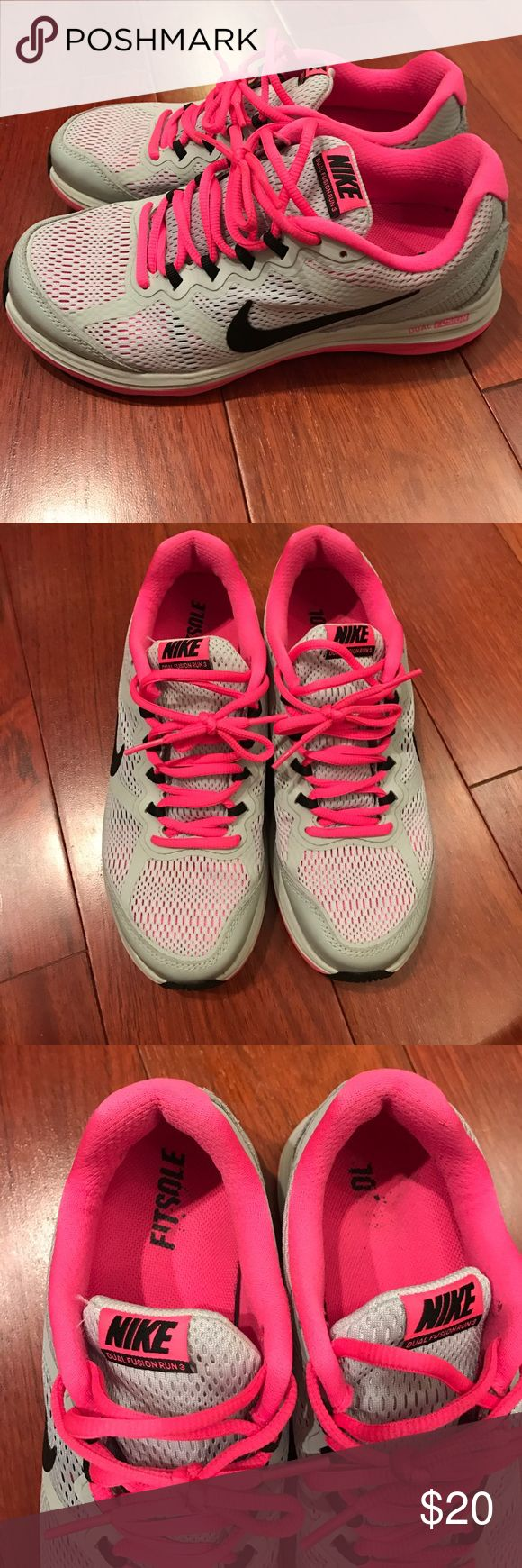 Nike Dual Fusion Run 3 Sneakers Good condition Nike Dual Fusion Run 3 size 7. These sneakers have been gently worn at inside gyms only. They are very light grey, hot pink, and black. Nike Shoes Sneakers
