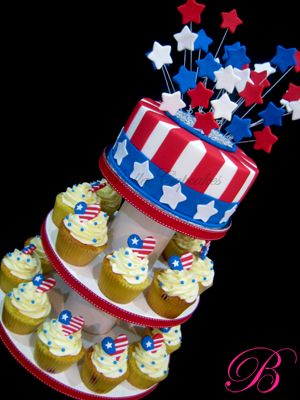 4th Of July Independence Day Cupcake Tower --- Love the red, white, and blue star explosion on top. I only wish they'd broadened the base on the top cake to make it into an Uncle Sam hat. Cute idea to make edible individual little American flag hearts for the cupcakes below. Gorgeous execution!