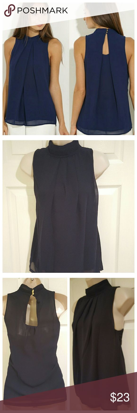 NWOT Navy Chiffon Blouse PRICE DROP New without tags. Dark navy blue color with 3 gold colored buttons at back of neck closure. Chiffon layered sleeveless blouse. Small upper back opening. Great for day/night out, can be dressed up with a blazer for professional look.  Multiple sizes available, see 4th pic for size chart. Tops Blouses