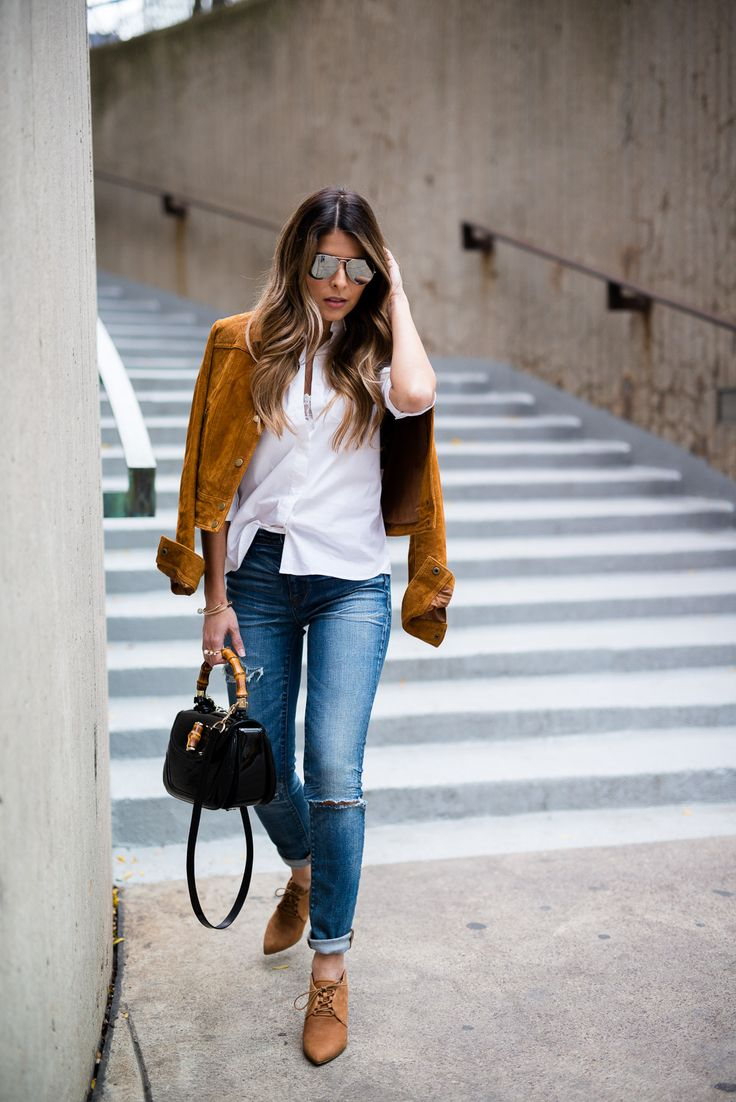 Pam Hetlinger wearing a tan faux suede jacket, nina shoes booties, madewell jeans, white button front shirt, gucci bamboo top handle handbag, free people lace crop top and mirrored aviators