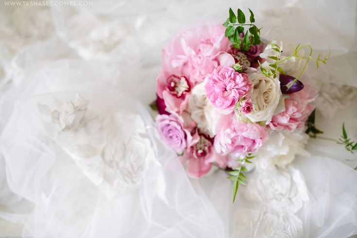 Jana's bridal bouquet by Flowers in the foyer. Photo by Tasha Seccombe