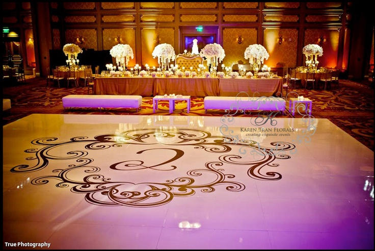 Custom seamless dance floor with opulent floral pieces at the grand del mar resort
