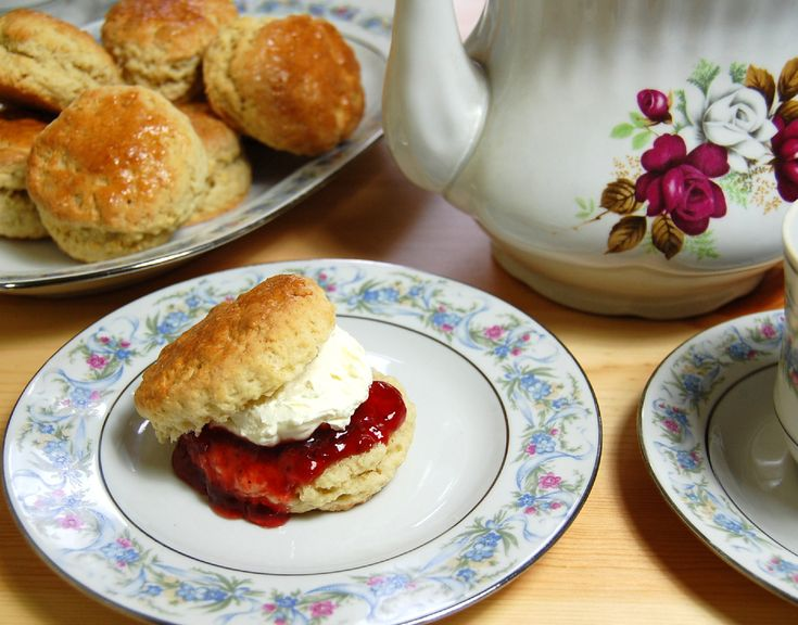 Scones with Clotted Cream and Jam  (and I think that's a Royal Albert teapot in the background)
