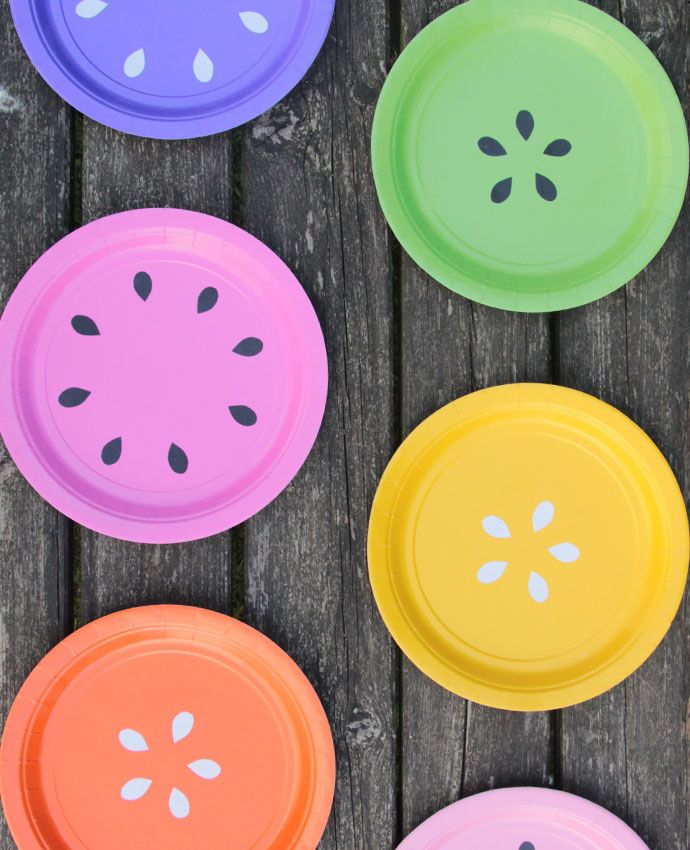 Turn plain-coloured plates into fruits by cutting pips out of black and white paper. This easy summer party DIY would be perfect for a tutti frutti party or Hawaiian party!