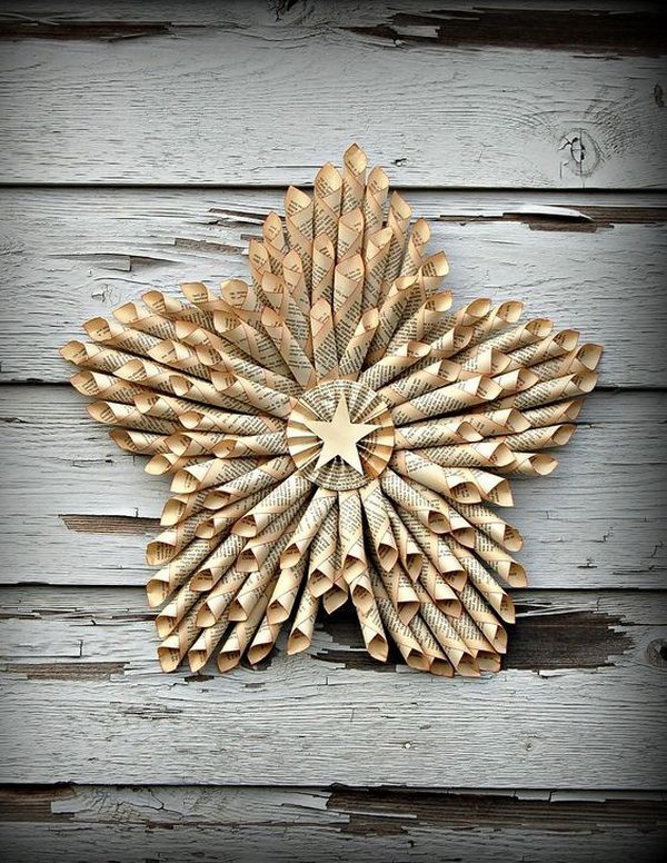 Star Wreath Made with Vintage Book Pages. This star wreath is handmade from well loved vintage book pages and make beautiful displays in your home, weddings, parties and more.