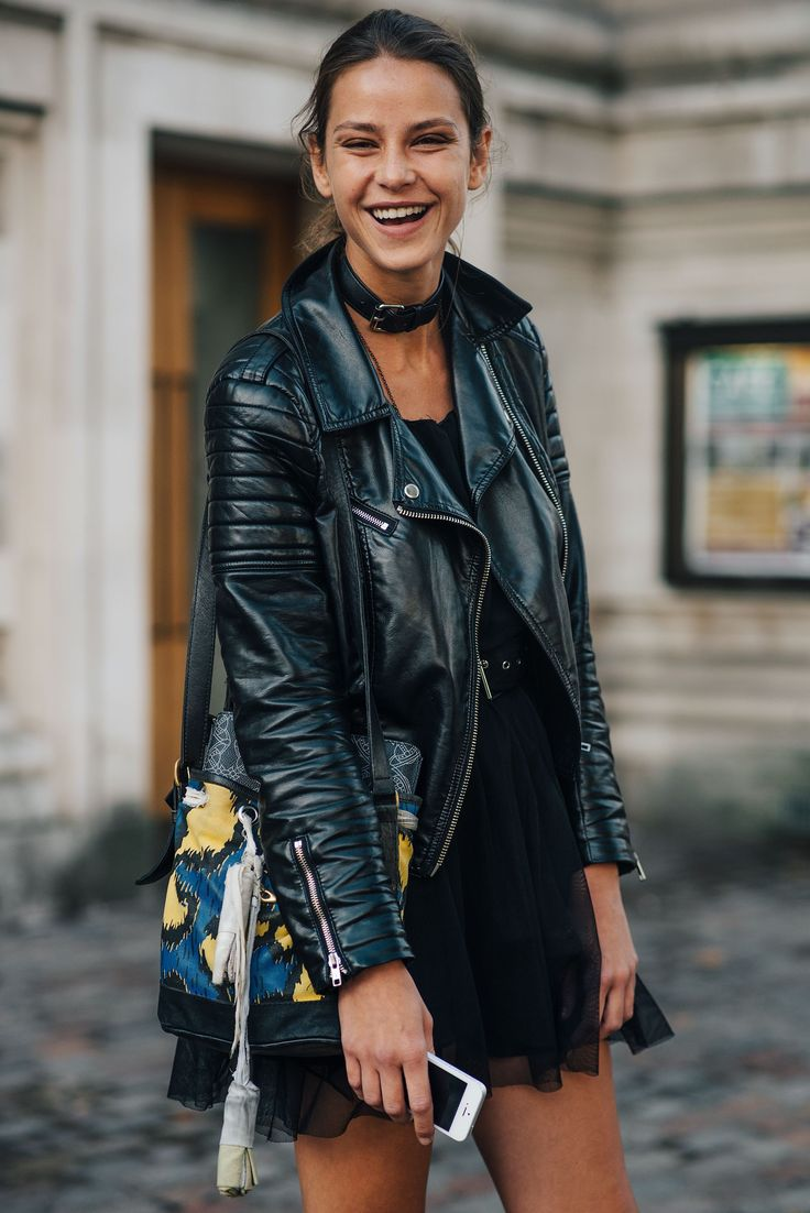 Biker Jacket mixed up with a leather belt choker and colourful bag.